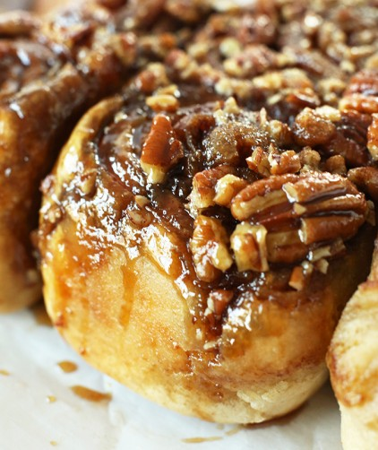 Close up shot of the gooey pecan topping on our recipe for The World's Easiest Sticky Buns