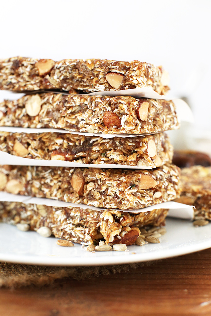 Stack of Super Seedy Vegan Granola Bars separated by parchment paper