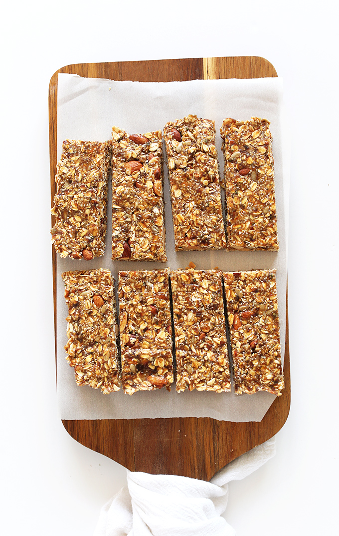 Freshly baked and sliced homemade vegan granola bars on a cutting board