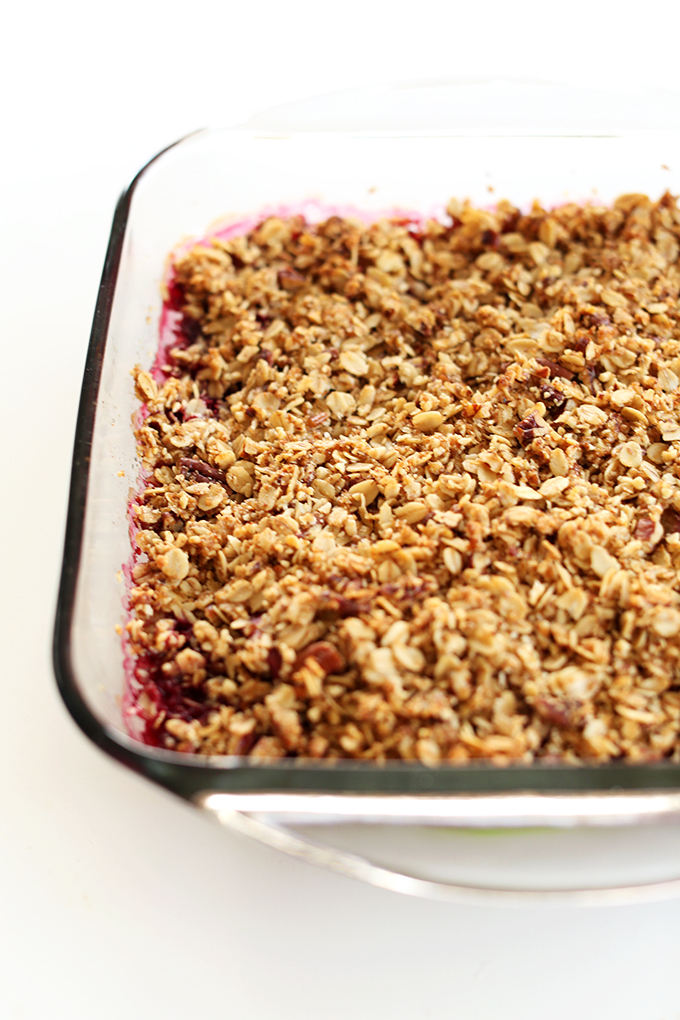 Glass baking dish filled with a batch of our gluten-free vegan Raspberry Rhubarb Crisp