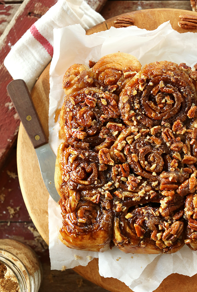 Batch of our Easy Vegan Sticky Buns topped with sticky glaze and pecans