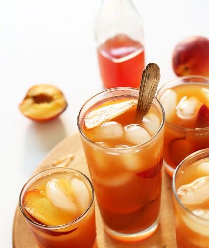 Fresh peaches and glasses of homemade Peach Iced Tea