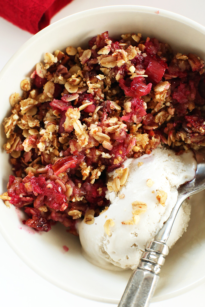 Bowl of Raspberry Rhubarb Crisp with vegan vanilla ice cream