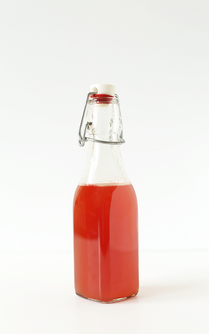 Bottle of homemade Peach Simple Syrup