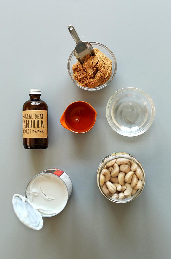 Cashews, coconut milk, vanilla, and other ingredients for making Vegan Cookie Dough Ice Cream