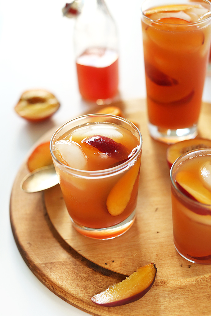 Glasses of Sweet Peach Iced Tea with ice cubes and slices of peaches in them