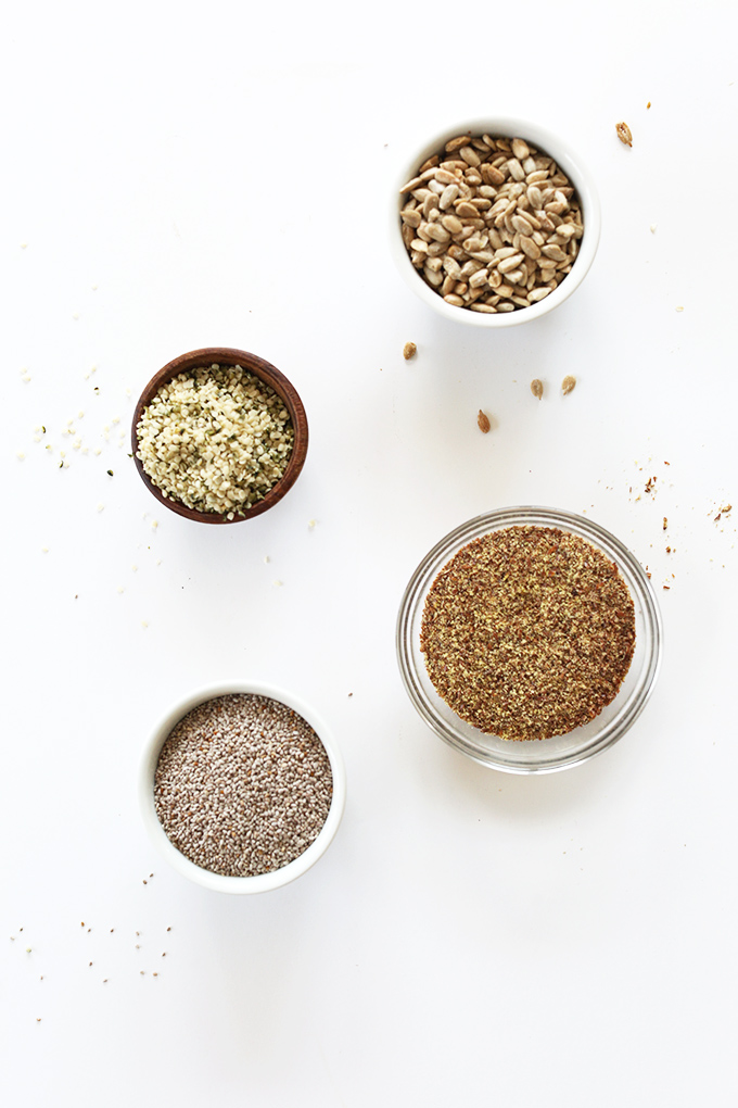 Bowls of sunflower, hemp, flax, and chia seeds for making homemade vegan granola bars