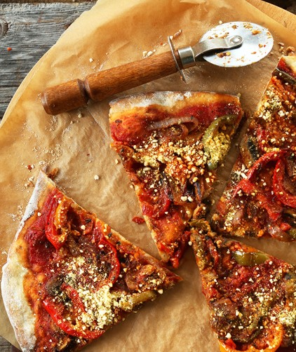 Parchment paper topped with slices of the Best Vegan Pizza