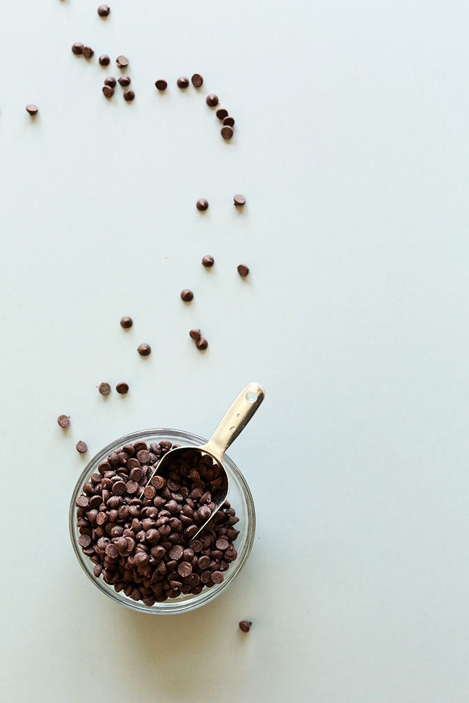 Bowl of vegan chocolate chips for making our Vegan Peanut Butter Cookie Dough Ice Cream recipe