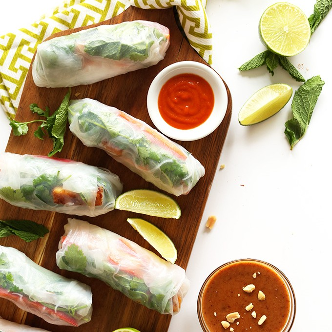 Cutting board with Vietnamese Vegan Spring Rolls made with Crispy Almond Tofu