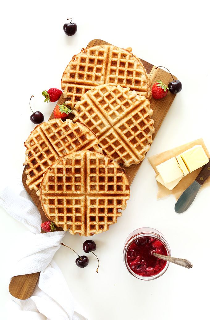 Freshly made Vegan Gluten-Free Waffles with vegan butter and fruit compote
