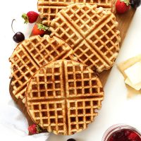 Homemade Freezer Waffles on a cutting board with fresh fruit