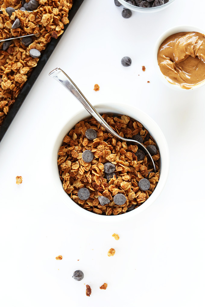 Bowl and tray of delicious Peanut Butter Chocolate Chip Granola