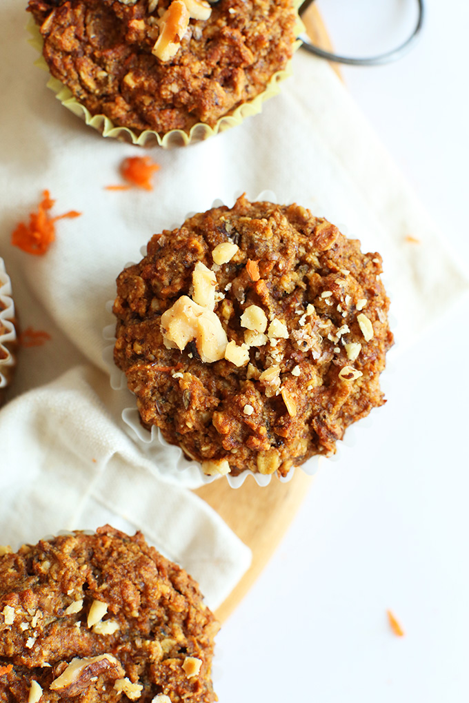 Gluten-free vegan Carrot Walnut Muffins resting on linens