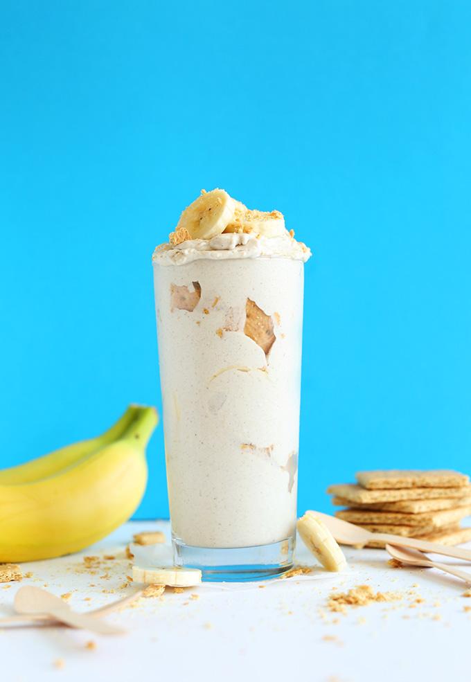 Glass jar of our Mega Creamy Banana Cream Pie Blizzard topped with fresh banana