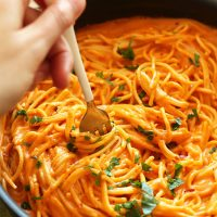 Using a fork to swirl a bite of Vegan Roasted Red Pepper Pasta