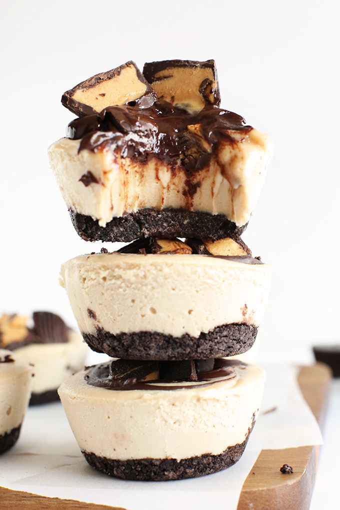 Stack of Vegan Peanut Butter Cup Cheesecakes with the top one partially eaten
