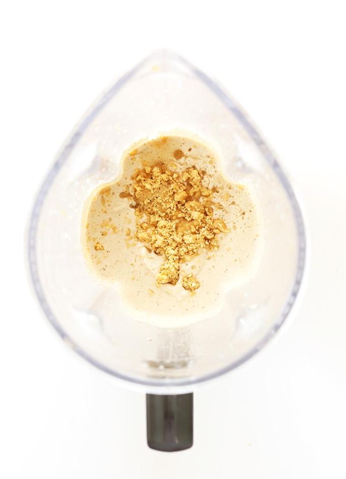 Blender filled with ingredients for Vegan Banana Cream Pie Blizzards