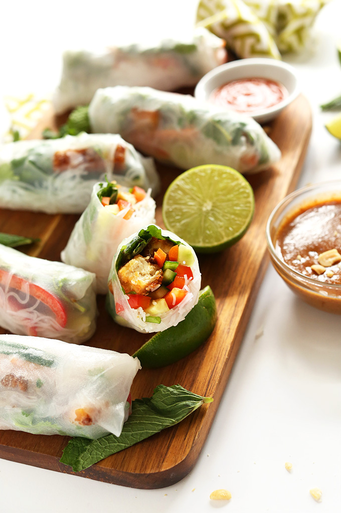Cutting board with fresh Vegan Vietnamese Spring Rolls with Crispy Tofu