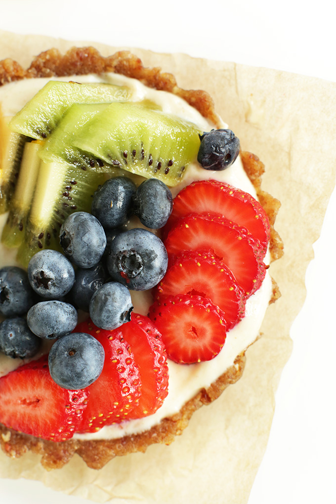 Parchment-square topped with a gluten-free vegan Lemon Cookie Fruit Tart