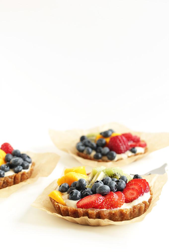Three of our gluten-free vegan Lemon Cookie Fruit Tarts