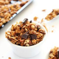 Bowl of Almond Joy Granola topped with dark chocolate pieces