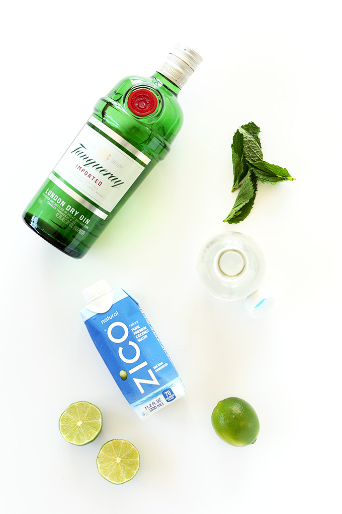 Coconut water, gin, limes, and mint for making Coconut Water Gin and Tonics
