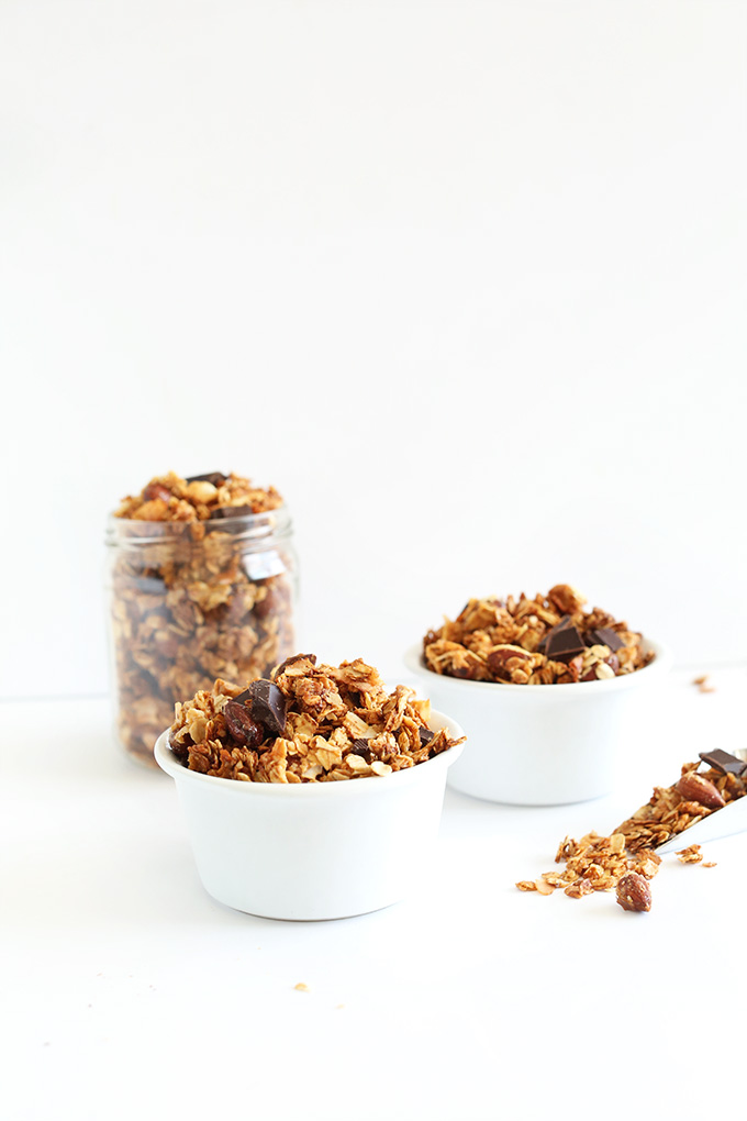 Jar and bowls loaded with our Almond Joy Granola recipe