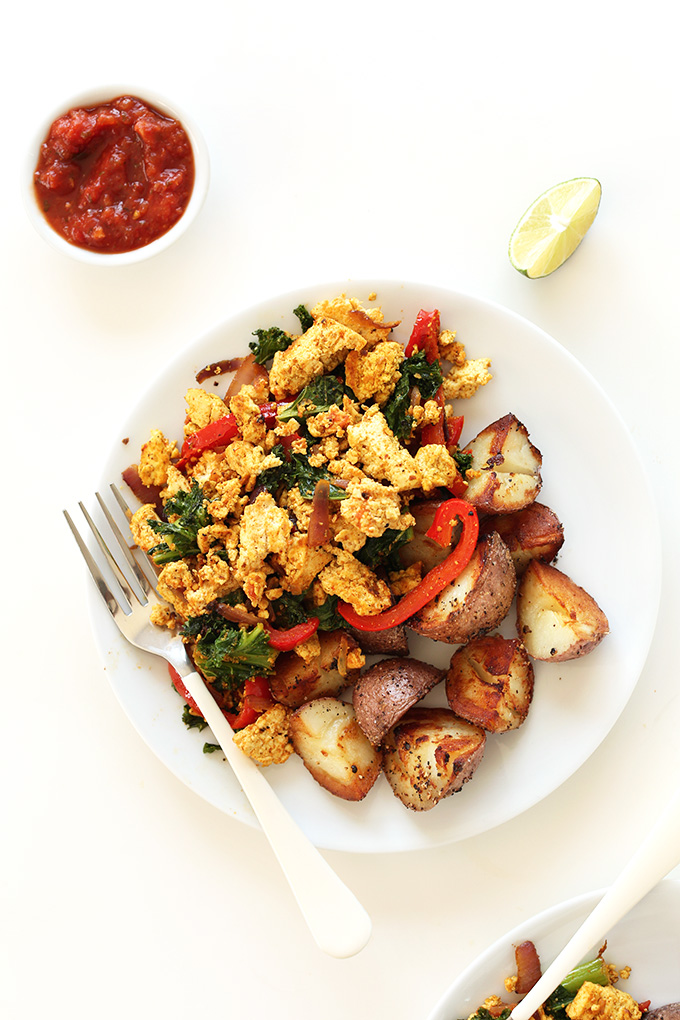 Breakfast plate of scrambled tofu and veggies plus roasted potatoes