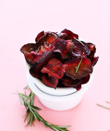 Stack of bowls with the top one overfilled with Baked Rosemary Beet Chips