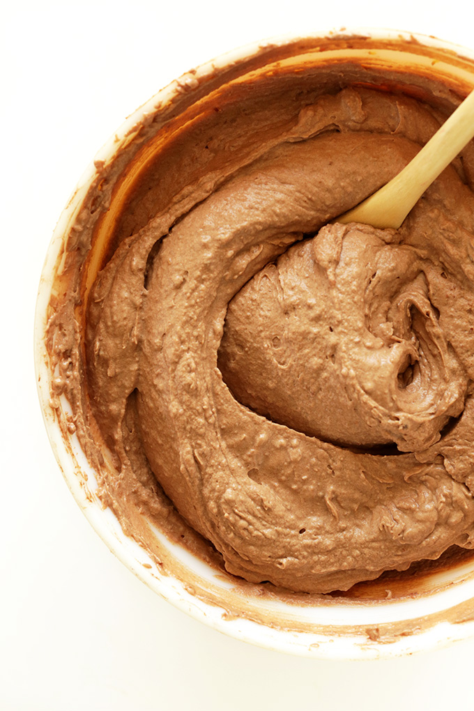 Using a spoon to stir our No-Churn Vegan Chocolate Ice Cream