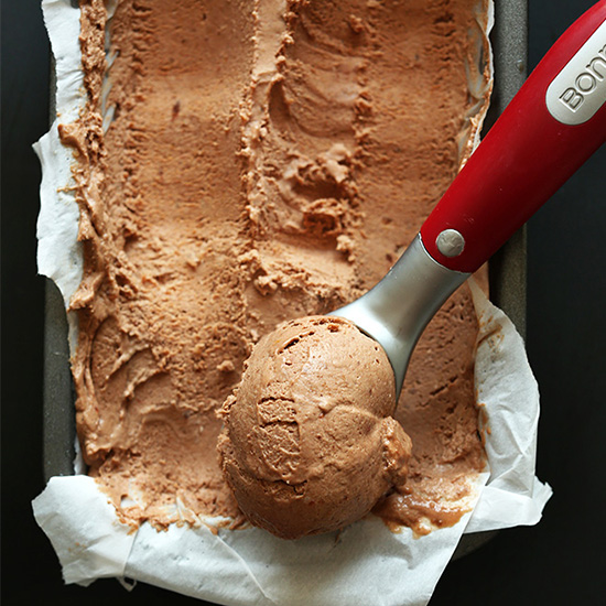 Using an ice cream scooper to scoop up homemade No Churn Vegan Chocolate Ice Cream