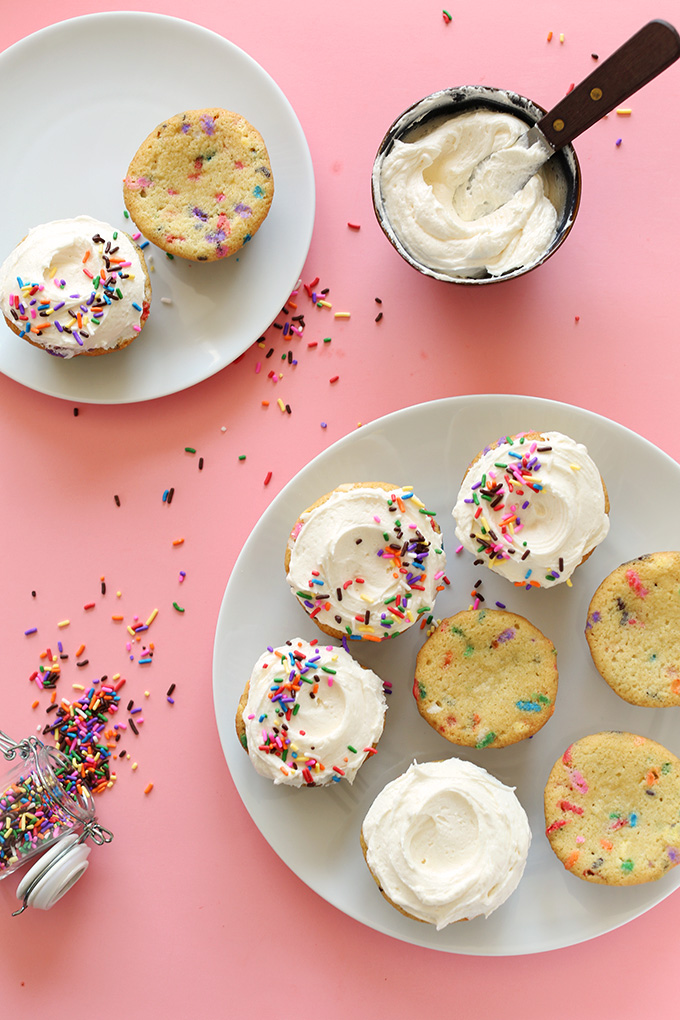 Plates of partially frosted Vegan Funfetti Cupcakes