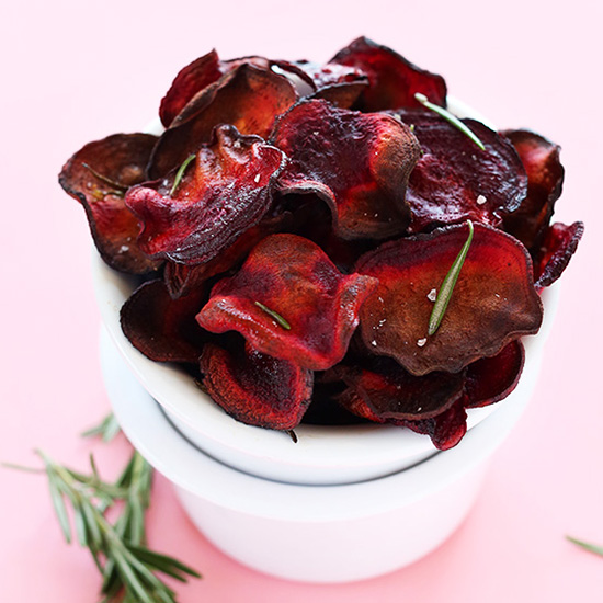 Stack of bowls holding a batch of Baked Rosemary Beet Chips