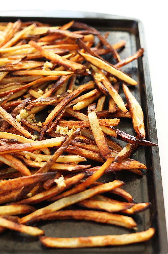 Baking sheet filled with super crispy Baked Matchstick Garlic Fries