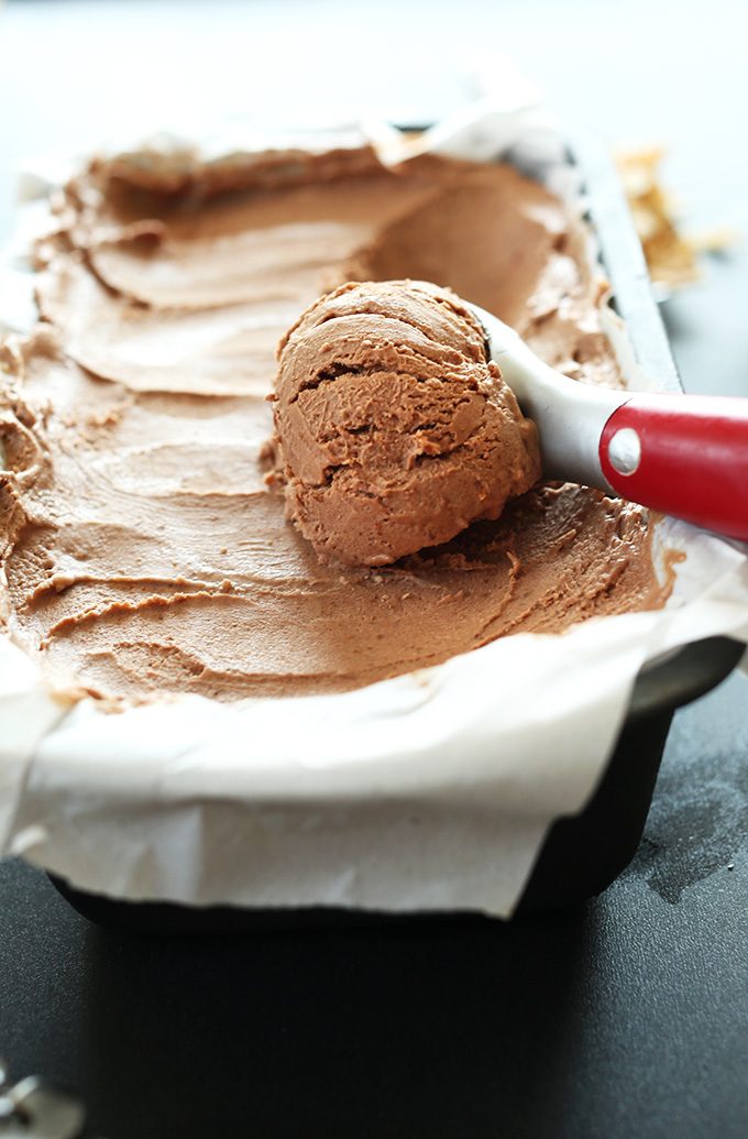 Using an ice cream scooper to grab a scoop of No-Churn Vegan Chocolate Ice Cream