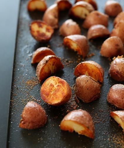 Batch of our crispy vegan Breakfast Potatoes on a baking sheet
