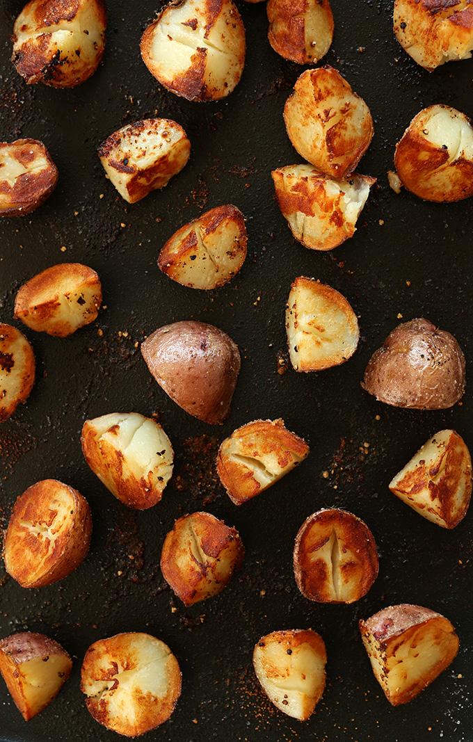 Baking sheet filled with a batch of crispy vegan breakfast potatoes