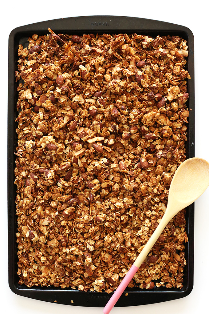Baking sheet with a batch of freshly baked vegan Almond Joy Granola