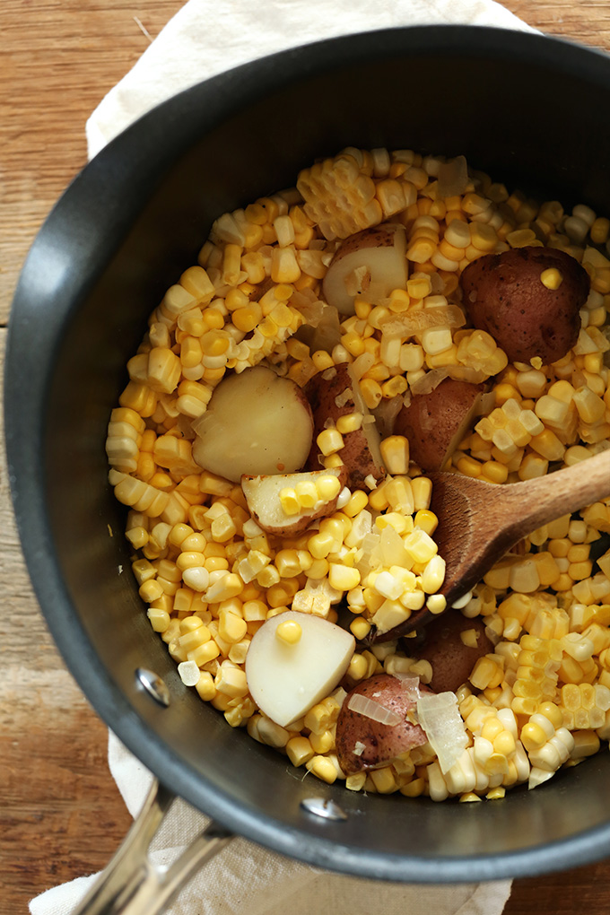 Cooking Cooking potatoes and corn for our simple Vegan Corn Chowder recipe
