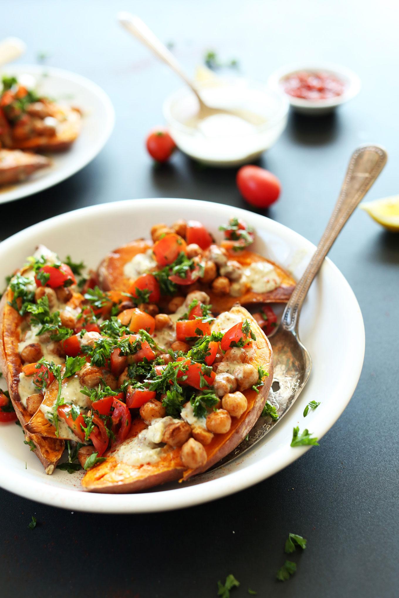 Close up shot of a bowl of gluten-free vegan Mediterranean Baked Sweet Potatoes