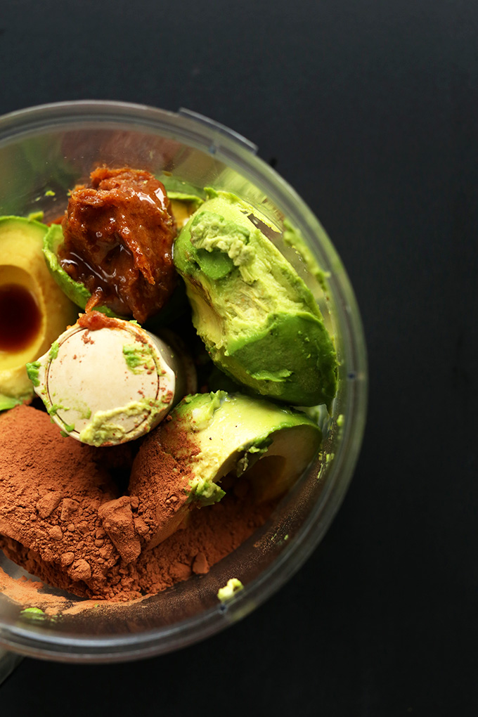 Food processor with ingredients for making vegan Chocolate Avocado Pudding