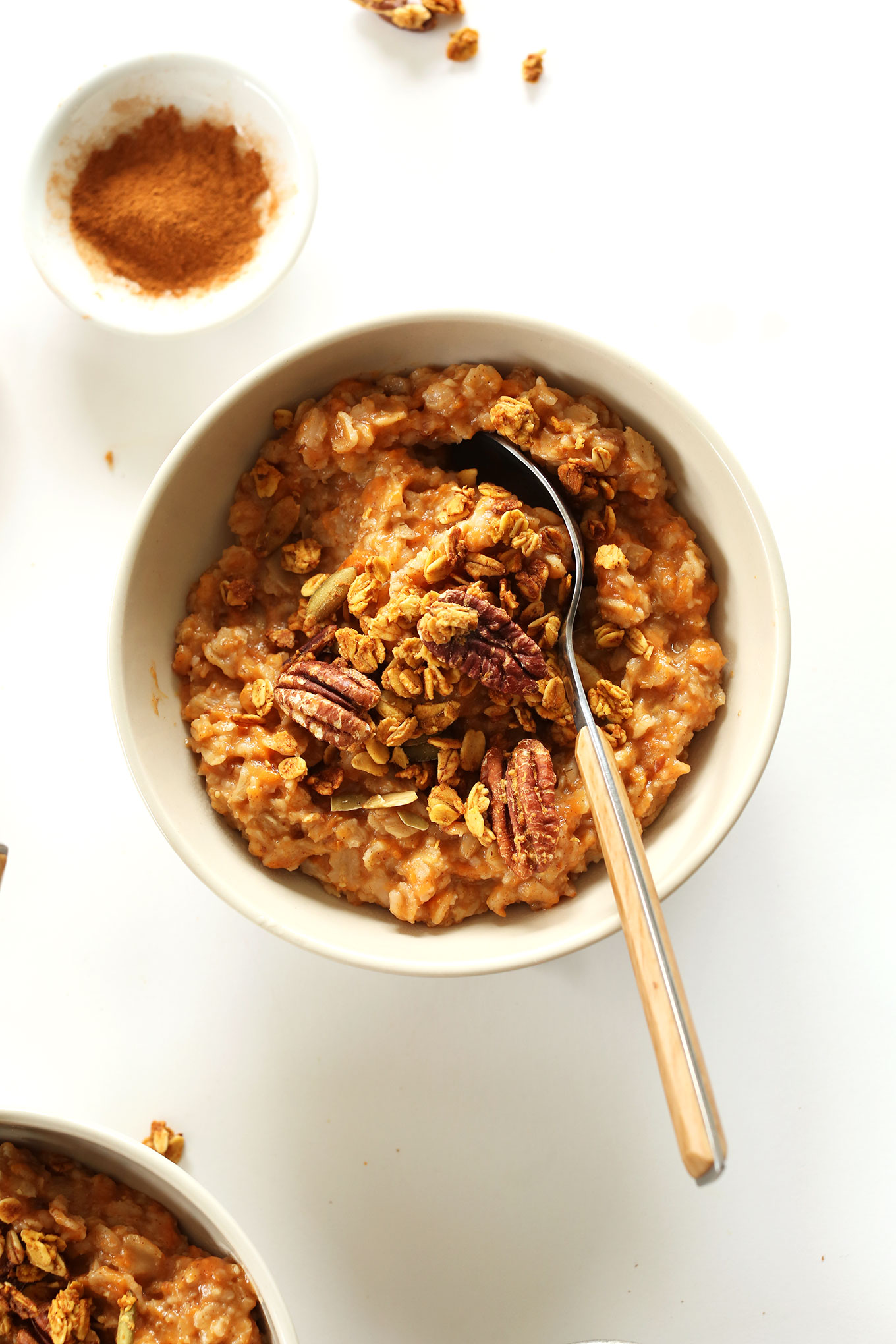 Bowl of our delicious Sweet Potato Pie Oats topped with pecans
