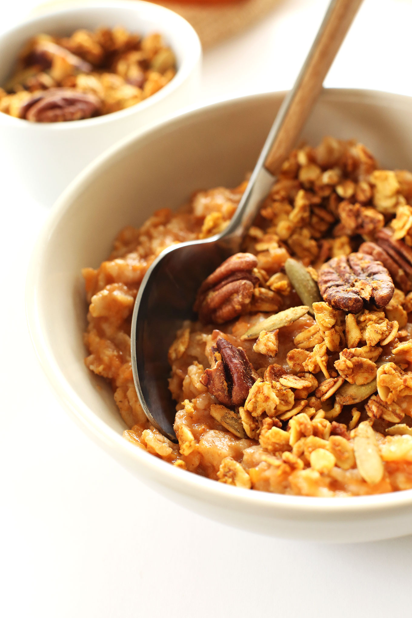 Close up shot of a bowl of our Sweet Potato Pie Oats for a healthy breakfast recipe