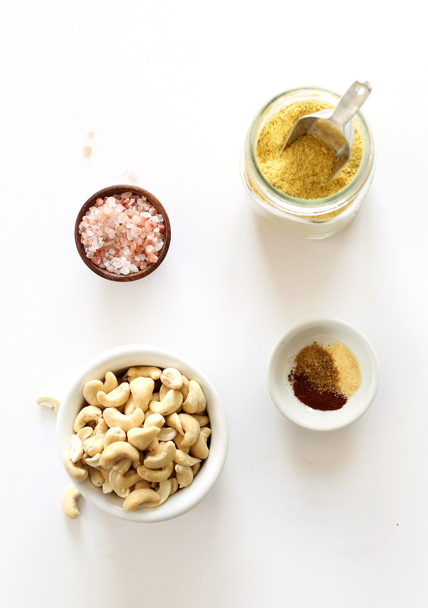 Cashews, salt, nutritional yeast, and spices for making Easy Vegan Mexican Cheese