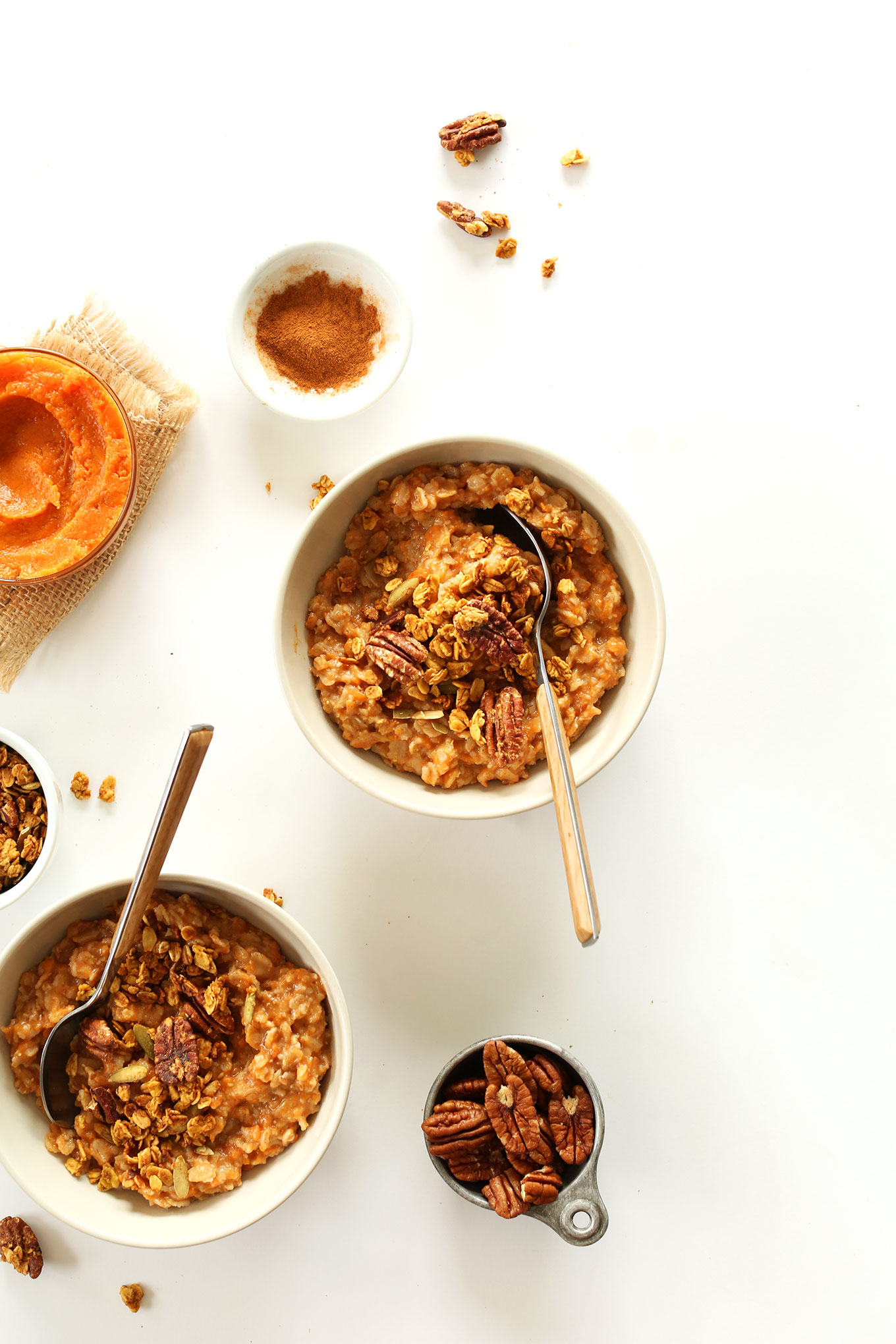 Bowls of our healthy Sweet Potato Pie Oats topped with pecans