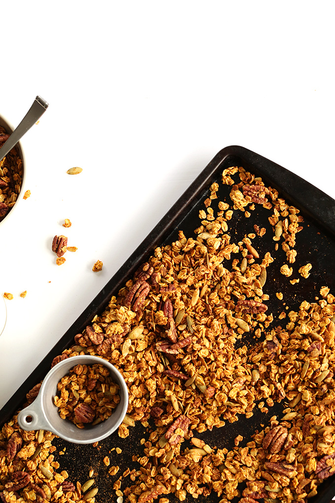 Baking sheet filled with a batch of our gluten-free vegan Maple Pecan Granola recipe