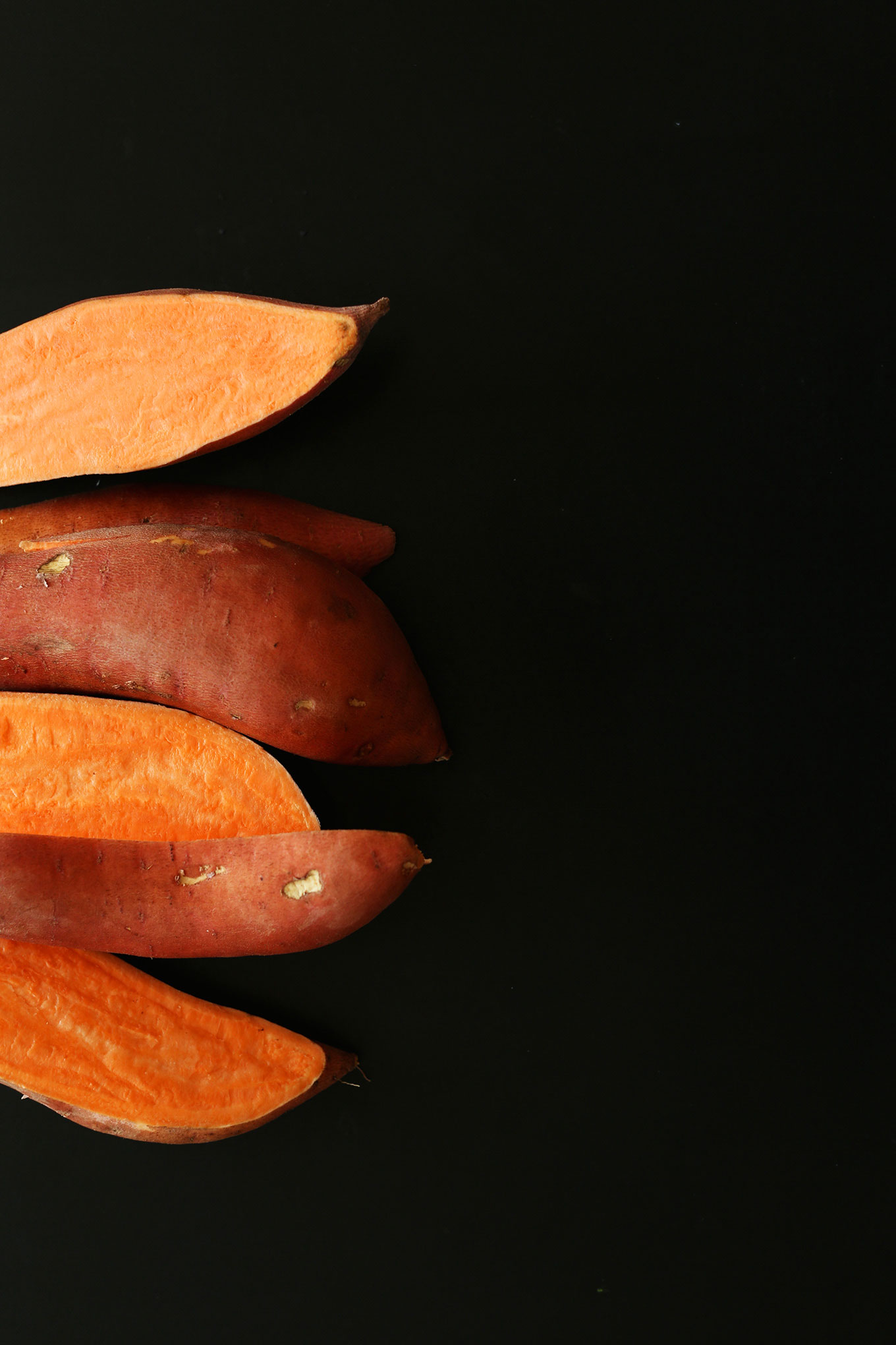 Several halved skin-on sweet potatoes