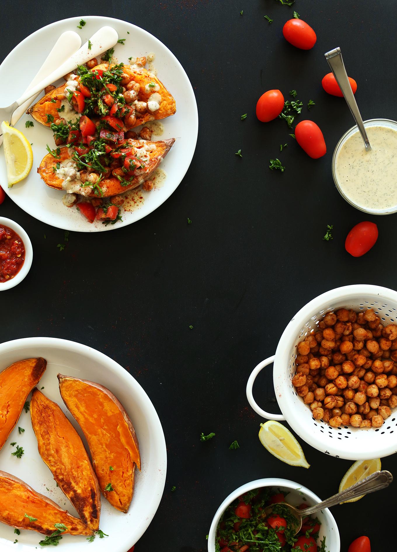 Plate of gluten-free vegan Mediterranean Baked Sweet Potatoes alongside ingredients for making them