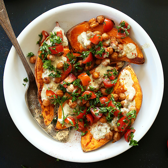 Bowl of Mediterranean Baked Sweet Potatoes for a simple and healthy vegan meal